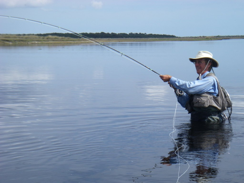 The author photographed in action wade fly fishing the upper St. Johns River in Florida. Photo by Lars Lutton.